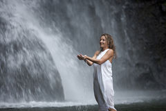 Woman Under Waterfall Royalty Free Stock Photos