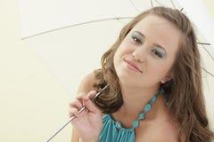 Woman under a white umbrella Stock Photo