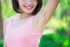 Woman with underarm hair removal stock image