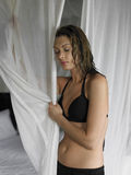 Woman In Undergarments Holding Curtains Royalty Free Stock Photo