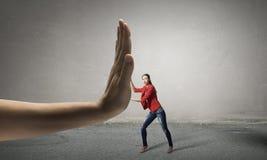 Woman undergo authority power . Mixed media Stock Photography
