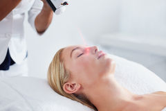 Woman undergoing local cryotherapy at spa stock images