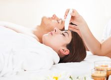 Woman undergoing microdermabrasion therapy Royalty Free Stock Images