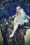 Woman underwater stock images