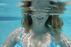 Woman underwater. An underwater view of a woman partly underwater Stock Photography