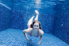 Woman Underwater. An underwater shot of a woman in a swimming pool Royalty Free Stock Photography