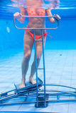 Woman in underwater gymnastics therapy Royalty Free Stock Images