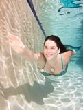 Model underwater in a pool wearing a mermaids tail. Royalty Free Stock Image