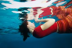 Woman underwater with reflection from surface royalty free stock photos