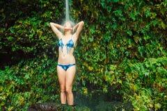 Woman underwaterfall in Hawaii Stock Photography
