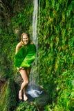 Woman underwaterfall in Hawaii Stock Photos