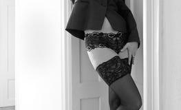 Woman in underwear. A woman is wearing black stockings Stock Photo