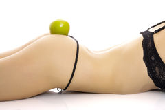 Woman in underwear with an apple on her buttock. Royalty Free Stock Photos