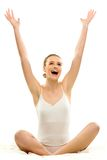 Woman in underwear with arms raised Stock Photo