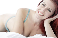 Woman in underwear on bed Stock Photo