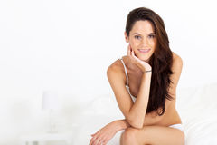 Woman in underwear on bed Royalty Free Stock Photos