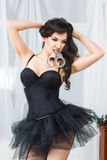 Woman in underwear, bite handcuffs, bdsm, sex toy Royalty Free Stock Photo