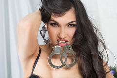 Woman in underwear, bite handcuffs, bdsm, sex toy Stock Photo