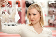 The woman in an underwear boutique Stock Images