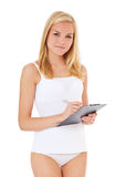Woman in underwear with clipboard Stock Photography