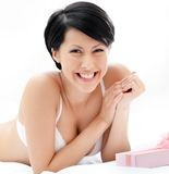 Woman in underwear finds a present in bed Royalty Free Stock Image