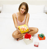 Woman in underwear finds a surprise in bed Stock Photos