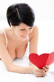 Woman in underwear hands a heart shaped post card Royalty Free Stock Photography