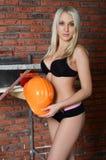 Woman in underwear in a helmet Royalty Free Stock Photos