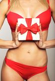 Woman in underwear holding gift Royalty Free Stock Image