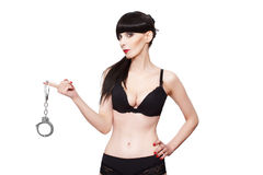 Woman in underwear holding handcuffs Stock Photo