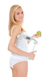 Woman in underwear holding personal scale royalty free stock photography