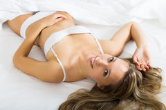 Woman in underwear  laying on bed Royalty Free Stock Image