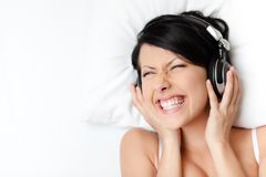 Woman in underwear listens to music Royalty Free Stock Photos
