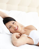 Woman in underwear is lying in the comfortable bed Royalty Free Stock Photography