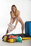Woman in underwear packing case Stock Photography