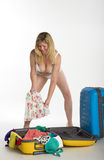 Woman in underwear packing suitcase Royalty Free Stock Photo
