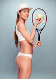 Woman in Underwear with Tennis Racquet and Ball Stock Images