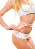 woman in underwear with white measure tape Stock Photography