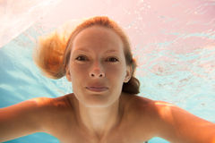 Woman undewater in the swimming pool Royalty Free Stock Images