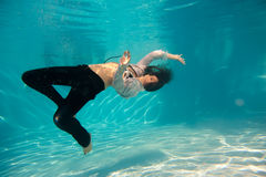Woman undewater in the swimming pool Stock Photos