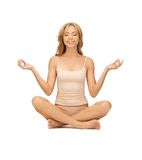 Woman in undrewear practicing yoga lotus pose Stock Photography