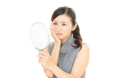 Woman with an uneasy look. Stock Images