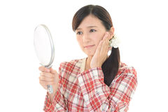 Woman with an uneasy look Royalty Free Stock Image