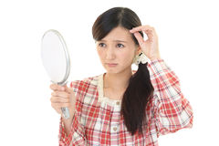 Woman with an uneasy look Royalty Free Stock Photography