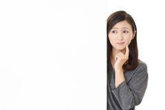 Woman with an uneasy look. Portrait of woman looking uneasy stock images