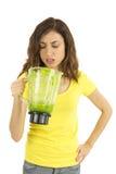 Woman unhappy about the green smoothie Stock Photos