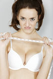 Woman unhappy with her measurements Stock Photo