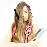 Woman unhappy about messy hair stick in brushes and combs isolated Stock Photography