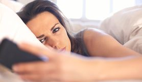 Woman Unhappy with a Text Message Stock Images