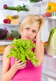 Woman unhappy vegetable salad diet, refrigerator Royalty Free Stock Photos